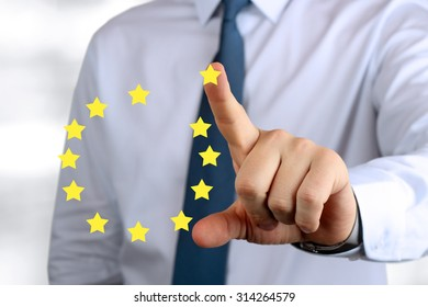 Business Man pushing on a European Union sign. leave the euro