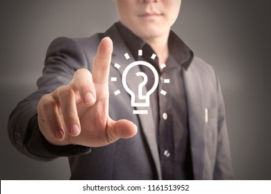 Business Man pushing on a light bulb icon technology and inovation concept