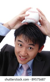 Business man put baseball on his head