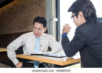 Business man quarrel between meeting in the coffee shop