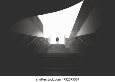 business man raising stairs to reach the city