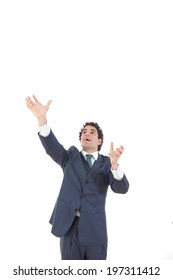 business man reaching to grab something from above his head, man in suit taking something up with hand with empty copy space form above