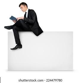 Business man reading on empty board