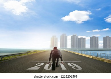 Business man ready to run toward the city 2019. Business  concept