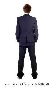 Business man in rear view, full length portrait isolated over white background.