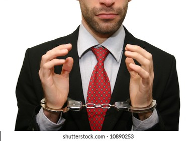 business man with red necktie and black suit in handcuffs isolated on white