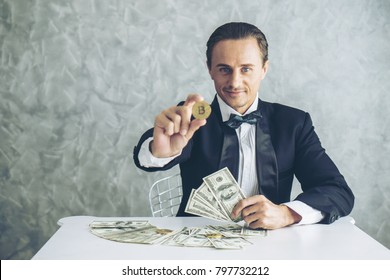 Business man rich trader holding bitcoin golden coin for business bitcoin trader exchange , business trader concept