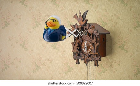 Business man rubber duck coming out of cuckoo clock