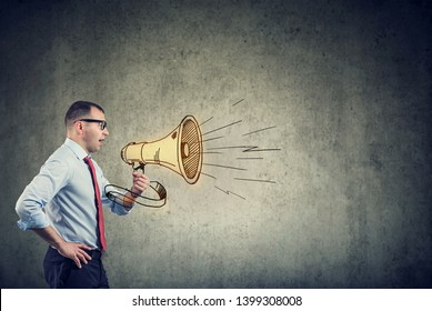 business man screaming into a megaphone making an announcement