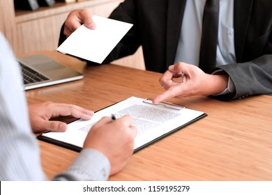 Business man sending resignation letter to boss and Holding Stuff Resign Depress or carrying cardboard box by desk in office