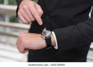 Business man serious about time