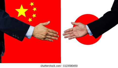 A business man shake each other hand, China and Japan