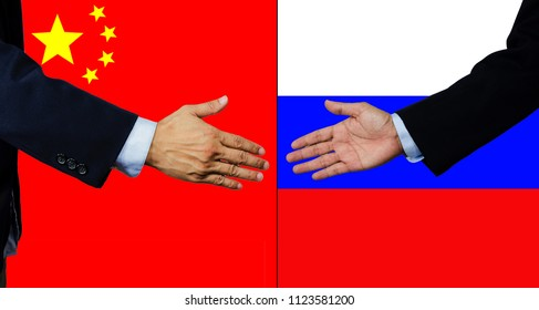 A business man shake each other hand, China and Russia