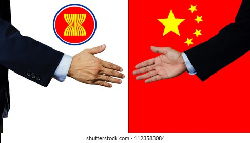 A business man shake each other hand, AEC and China