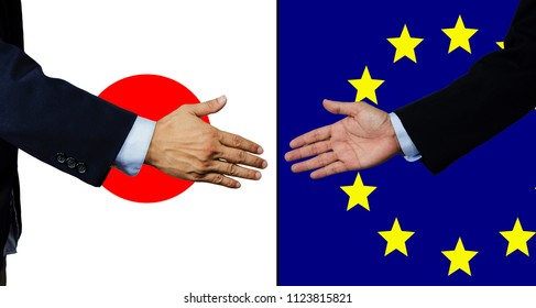 A business man shake each other hand, japan and EU