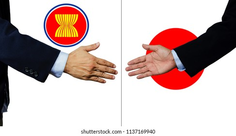 A business man shake each other hand, asian economic community and japan