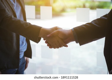 Business man shake hand after meeting and seal the deal for business planning project