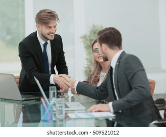 Business man shaking hand to  his partner
