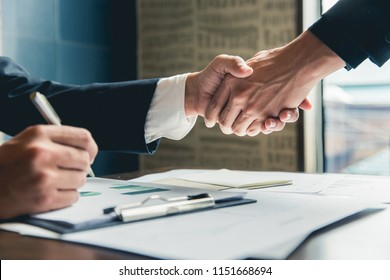 business man shaking hands during a meeting in the office, success, dealing, greeting and partner concept
