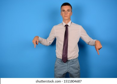 business man in shirt showing thumbs down on free place on a blue background