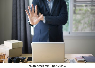 Business man Show hand Stop with  laptop computer on workingspace