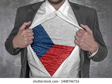 Business man show t-shirt flag of Czech Republic rips open his shirt