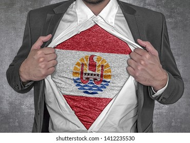 Business man show t-shirt flag of French Polynesia rips open his shirt