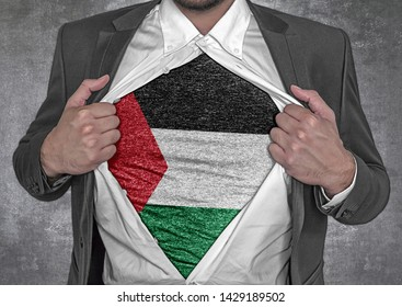 Business man show t-shirt flag of Palestine rips open his shirt