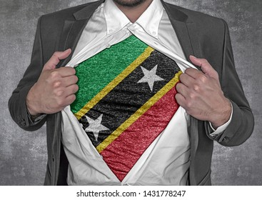 Business man show t-shirt flag of Saint Kitis and Nevis rips open his shirt