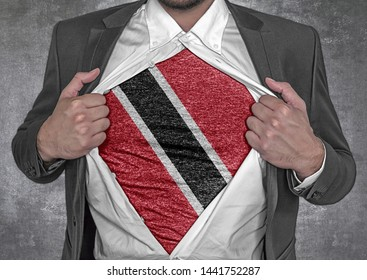 Business man show t-shirt flag of Trinidad and Tobago rips open his shirt