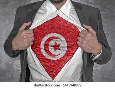Business man show t-shirt flag of Tunisia rips open his shirt