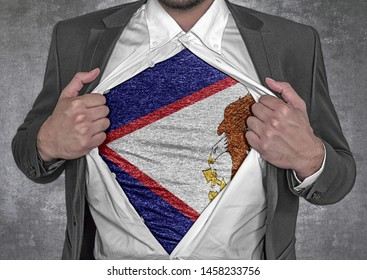 Business man show t-shirt flag of USA state American Samoa rips open his shirt