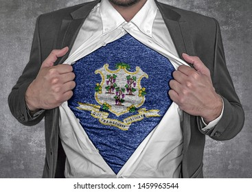 Business man show t-shirt flag of USA state Connecticut rips open his shirt