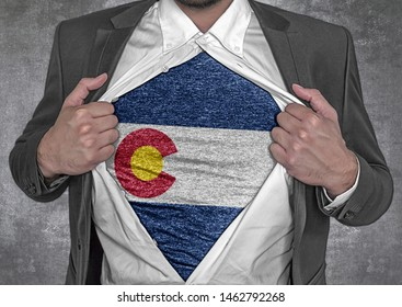 Business man show t-shirt flag of USA state Colorado rips open his shirt