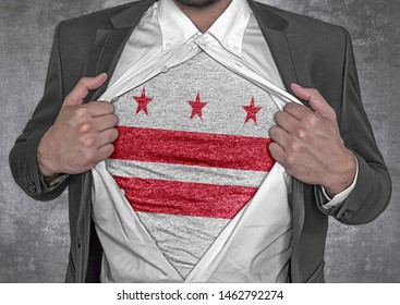 Business man show t-shirt flag of USA state District of Columbia rips open his shirt