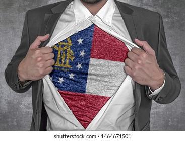 Business man show t-shirt flag of USA state Georgia rips open his shirt