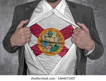 Business man show t-shirt flag of USA state Florida rips open his shirt