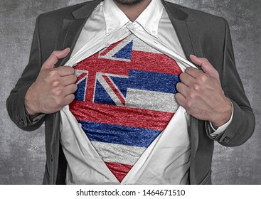 Business man show t-shirt flag of USA state Hawaii rips open his shirt