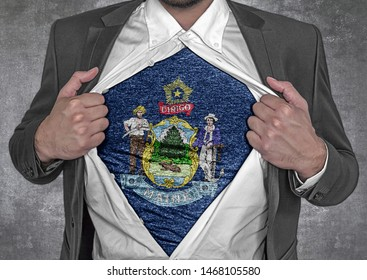 Business man show t-shirt flag of USA state Maine rips open his shirt