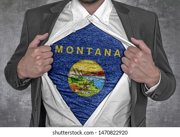 Business man show t-shirt flag of USA state Montana rips open his shirt