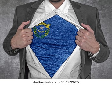 Business man show t-shirt flag of USA state Nevada rips open his shirt