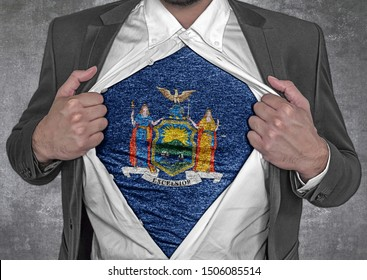 Business man show t-shirt flag of USA state New York rips open his shirt