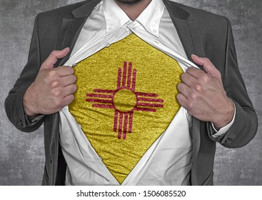 Business man show t-shirt flag of USA state New Mexico rips open his shirt