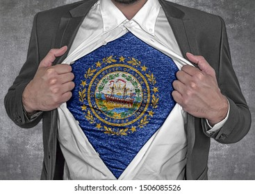 Business man show t-shirt flag of USA state New Hampshire rips open his shirt
