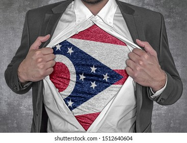 Business man show t-shirt flag of USA state Ohio rips open his shirt