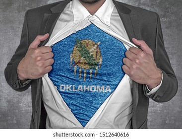 Business man show t-shirt flag of USA state Oklahoma rips open his shirt