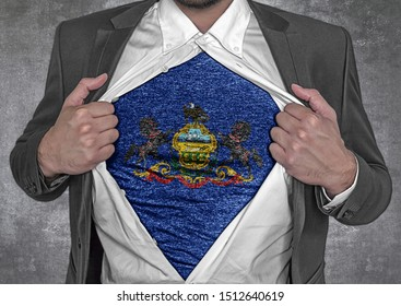 Business man show t-shirt flag of USA state Pennsylvania rips open his shirt