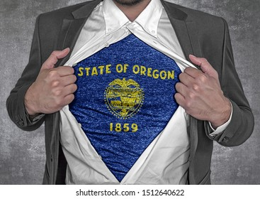 Business man show t-shirt flag of USA state Oregon rips open his shirt