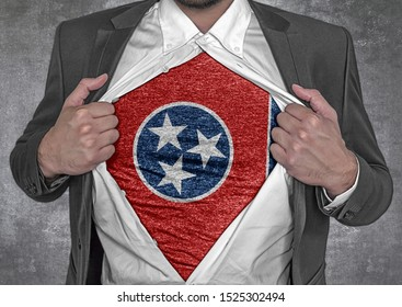 Business man show t-shirt flag of USA state Tennessee rips open his shirt