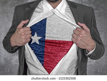 Business man show t-shirt flag of USA state Texas rips open his shirt